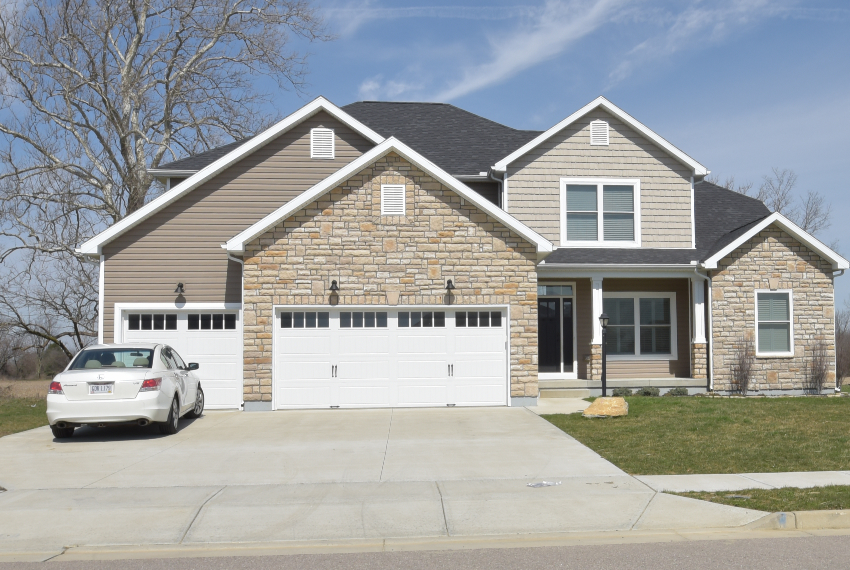 2 story Belmont model with stone, vinyl siding and shakes