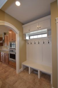 Built in the mud room includes transom window for natural light