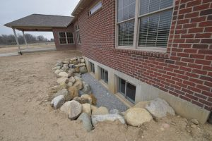 Boulders used in basement window well