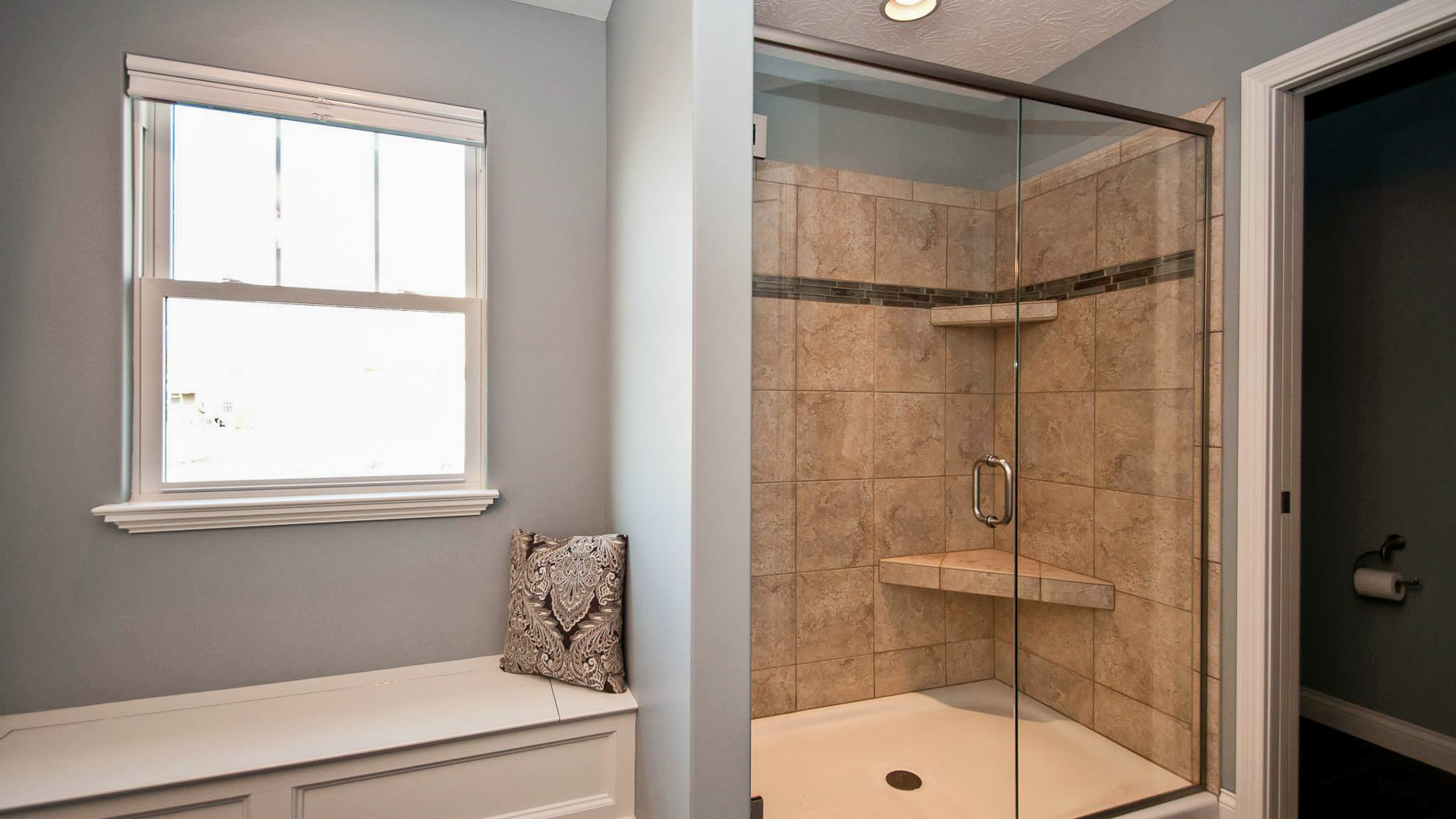 Shower with ceramic tile and separate built in bench