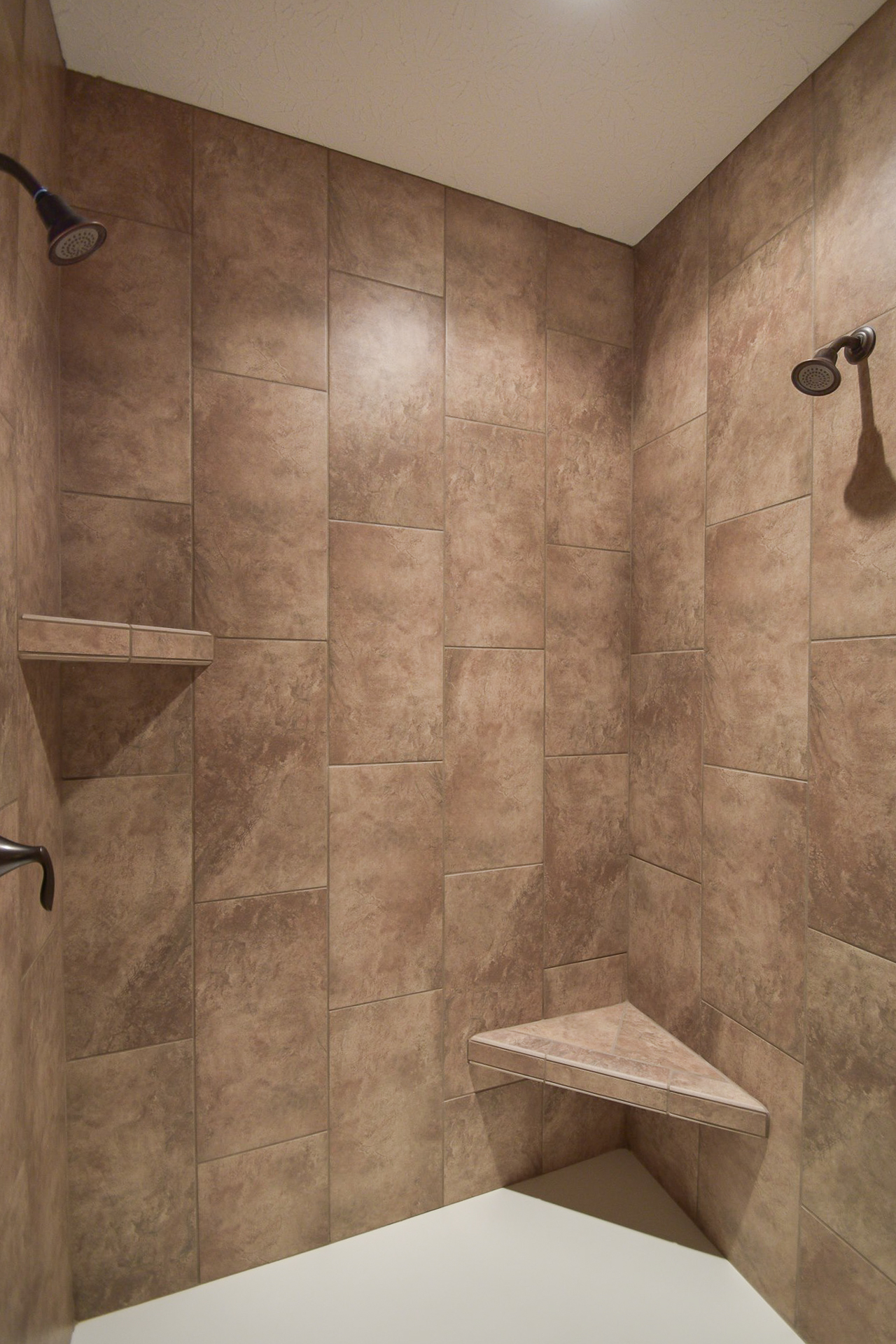 Ceramic tile shower with shelf and seat with dual Eva ORB fixtures