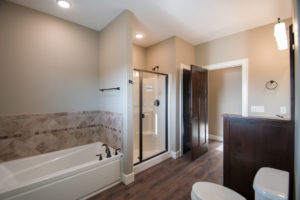 Whirlpool Exhibit 6036IFS air tub, Brantford fixture, 4' Aker S48 shower, Moduleo Embellish Highland Hickory flooring