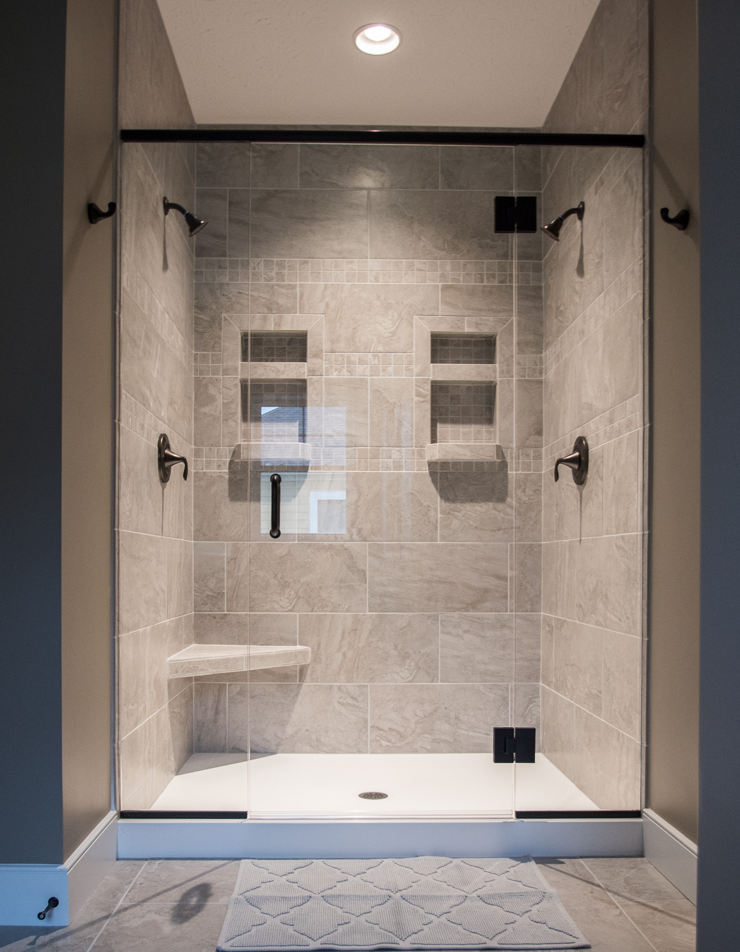 Master shower Florim Jewel Silver, 12X24 brick lay ceramic tile, dual Moen Eva oil rubbed bronze fixtures, recessed boxes and seat