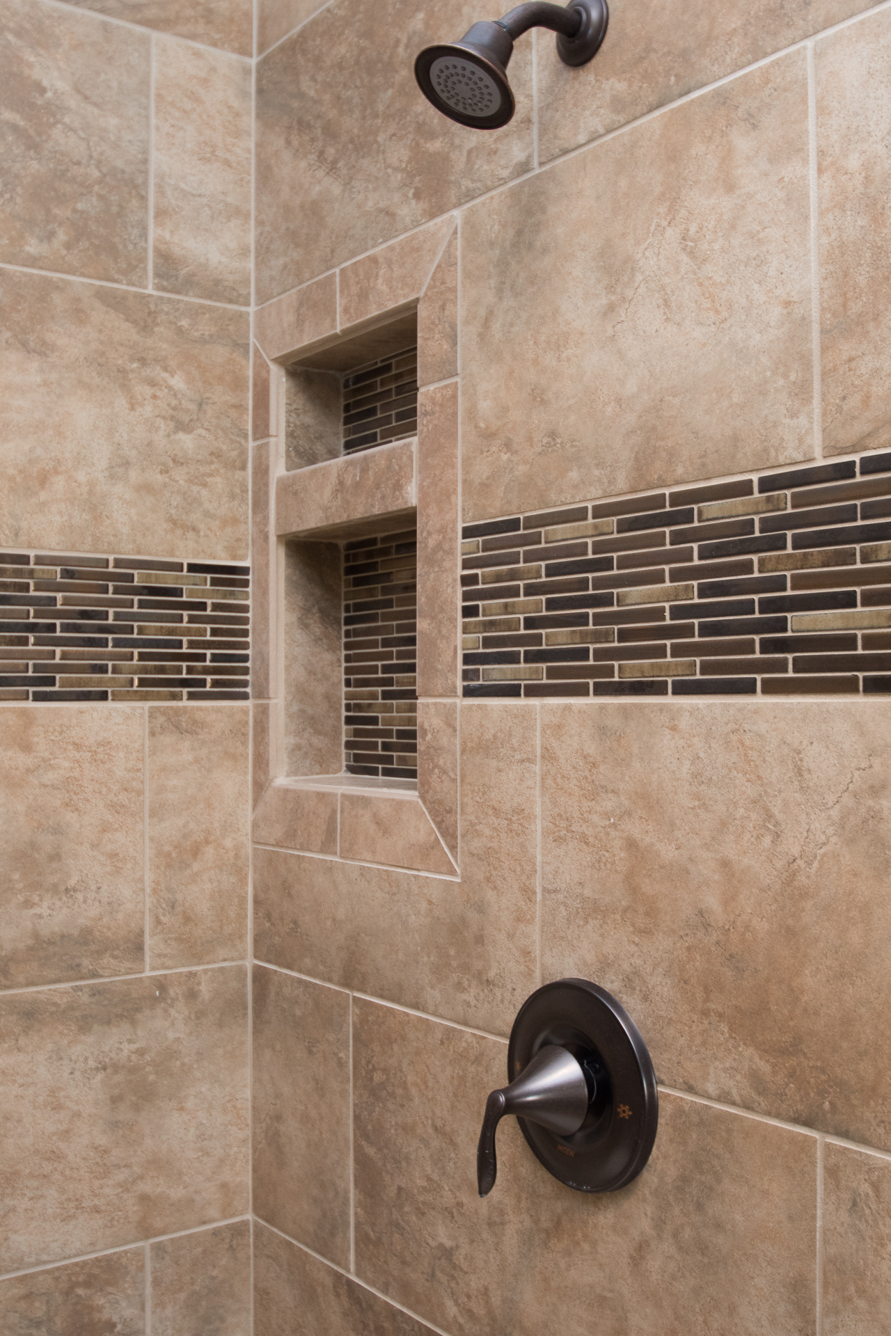 Bathrooms harlow builders inc stonefire noce 12x24 brick lay ceramic tile with accent strip moen eva oil dailygadgetfo Choice Image