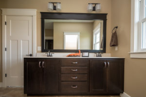 Norwich Truffle cabinets with oil rubbed bronze Eva fixtures