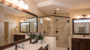 Master shower features 12x12 ceramic tile in brick pattern, and separate dual vanities