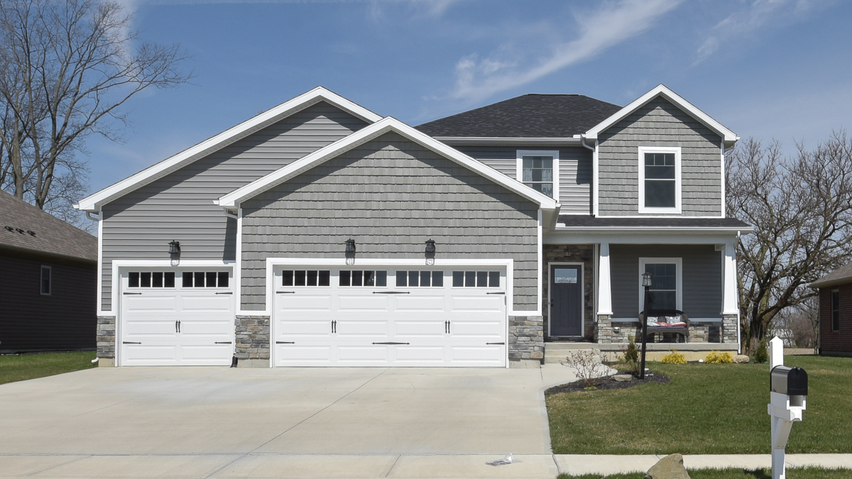Saratoga model with vinyl siding & shakes and stone built in Edgewater