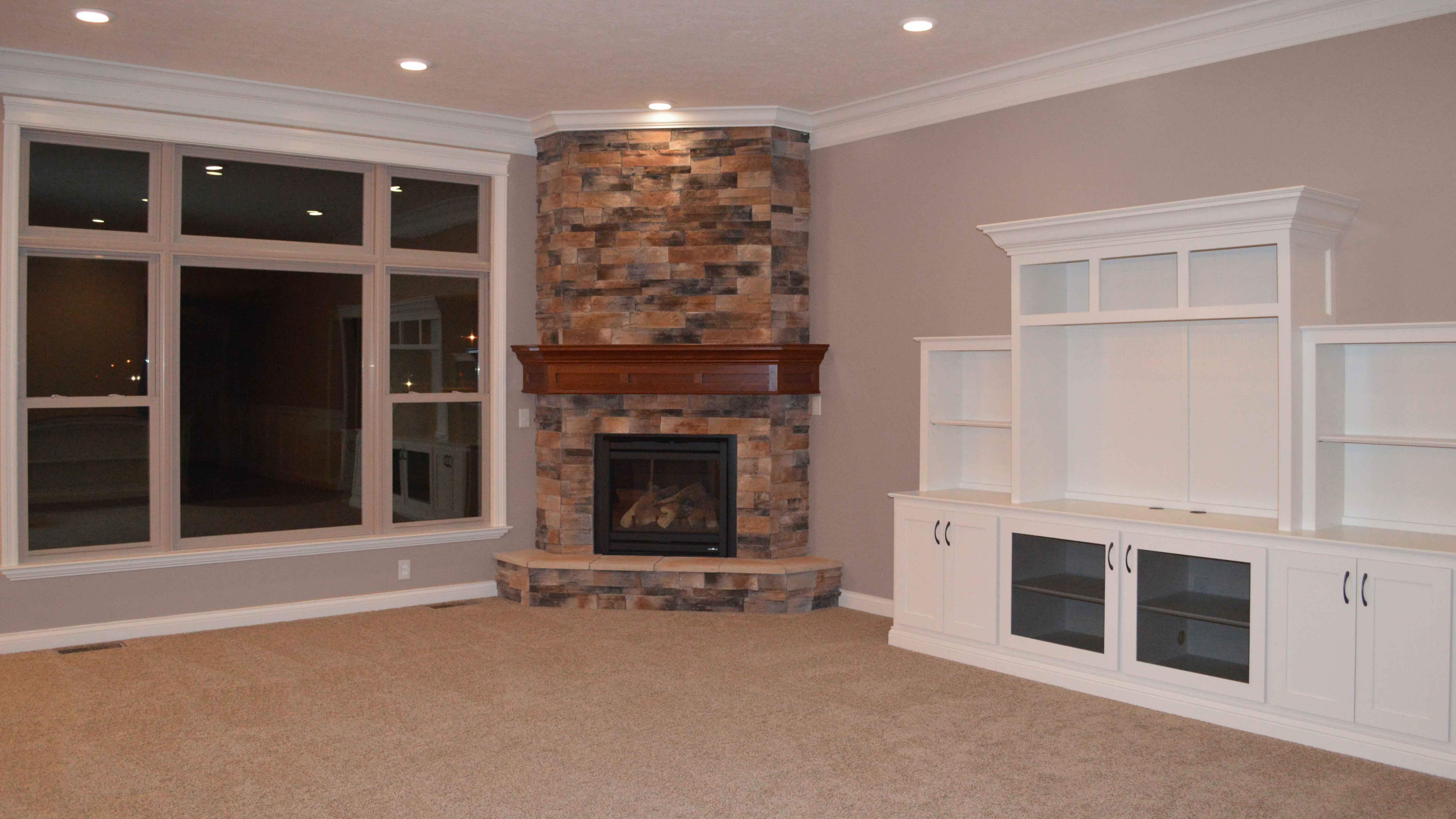 Gas Corner Fireplace With Sienna Dry Stack Stone Stained Mantle And Raised Hearth