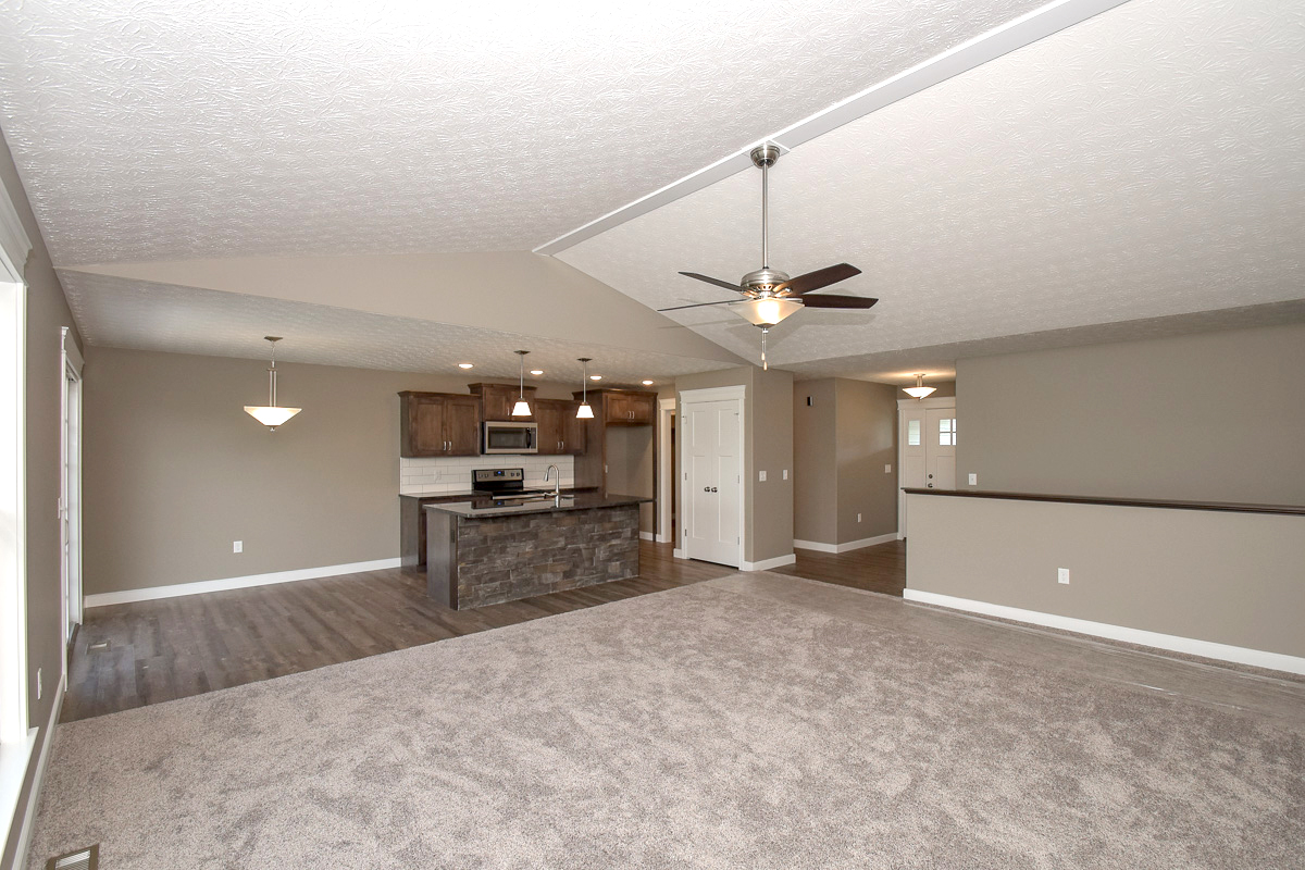 Great room is open to the kitchen and foyer