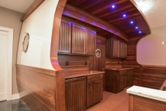 Custom built boat in the basement features authentic port hole and door from a shipyard, marine grade flooring, and teak wood!