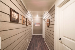 A private stairway located in the garage heads to the basement in this unique finish.
