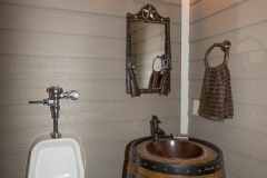 Unique men's bathroom in basement features genuine whiskey barrel vanity!