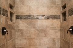 Stonefire Noce, 12X24, Brick lay ceramic tile with accent strip, Moen Eva oil rubbed bronze fixture