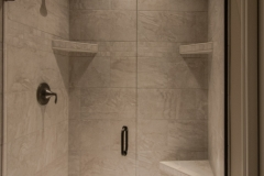 lorim Jewel Silver 12X24 brick pattern ceramic shower with 2 shelves and a seat, Moen Eva oil rubbed bronze fixture