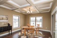 The breakfast nook in this Excalibur model features coffered ceilings with Keats light fixtures