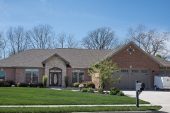 Modified Glendale model all brick with stone stoop features 3-car Gallery series garage door built in Stonebridge