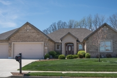 Excalibur all brick home features 3-car garage with short panel garage doors, dryvit stoop and trim built in Stonebridge (Troy)
