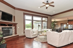 Glendale Great room features 11' ceiling, corner fireplace with stained trim accents.