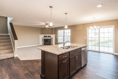 Great room in Saratoga model is open to the kitchen. Luxury Vinyl floor in Moduleo Old English Oak #24842