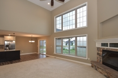 2 story great room of Belmont model features corner fireplace with Sienna drystack stone