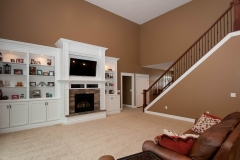 2 story great room of Belmont model features fireplace and built ins. Cypress Ledge Stone accent