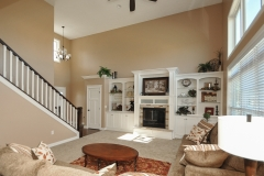 2 story great room of Arlington model with fireplace and flanking built ins