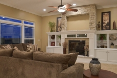 Great room of Allison model features 11' ceiling, centered fireplace with built ins. Arizona Dry Stack stone