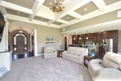 Custom home great room includes 12' coffered ceilings, a radius'd ceiling in foyer and all very open
