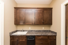 Laundry room with upper and lower cabinets and Drop-in Mustee 10C sink with Moen 7425 chrome faucet