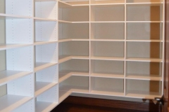 Master closet white melamine laminate shelving