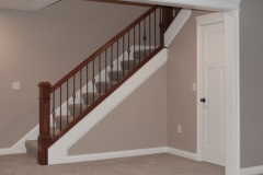 Stained newel posts & railings, and Single basket/twist/twist/single basket iron balusters