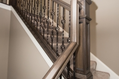 Stained railings & stained flat-panel box newels, Oil Rubbed Bronze balusters: alternating single basket & double basket