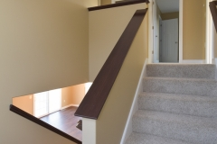 Half wall stair with stained trim