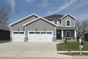 Grey Saratoga 2 story home with shakes, vinyl siding and some stone