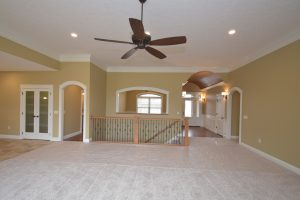 Great room of Glendale model is very open to the kitchen and formal dining area