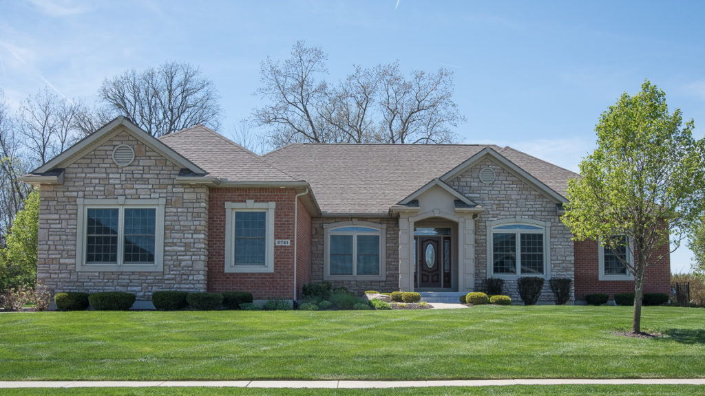 Glendale model with brick and limestone and dryvit stoop and trim built in Stonebridge (Troy)