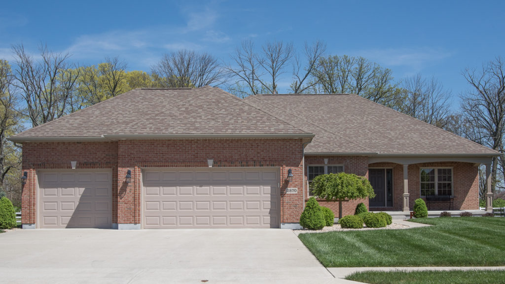 Custom ranch home with all brick exterior, 3-car garage with short panels built in Stonebridge (Troy).
