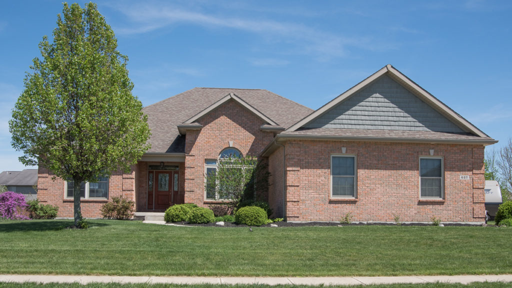 Custom built ranch home with brick and shake accent in gable built in Stonebridge (Troy)
