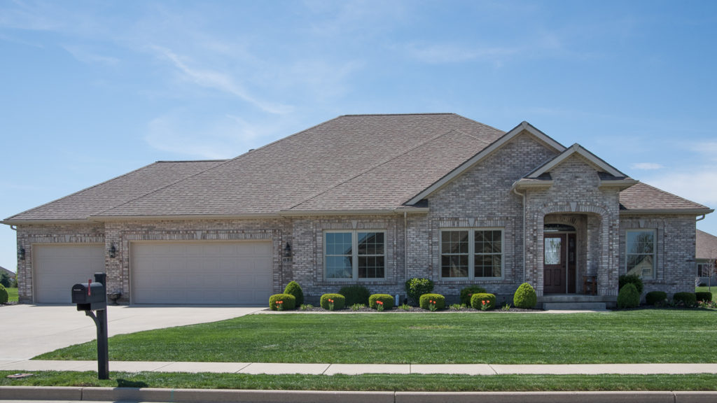 Modified Edgebrook model all brick with 3 car garage built in Stonebridge (Troy)
