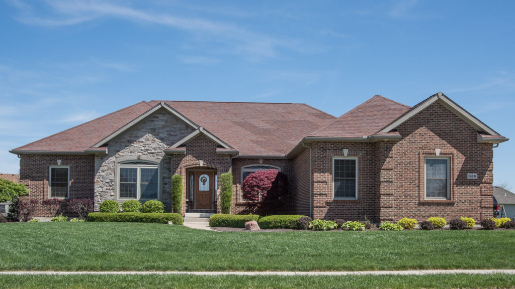 Glendale model with brick and stone built in Stonebridge (Troy)