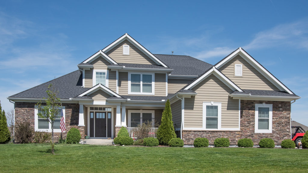 Berkshire model with stone and painted LP Smart Siding built in Stonebridge (Troy)