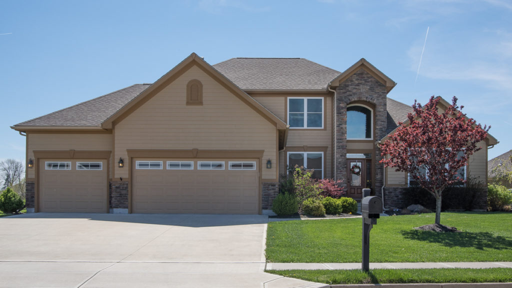 Belmont modified with painted LP Smart Siding and stone stoop built in Stonebridge (Troy)
