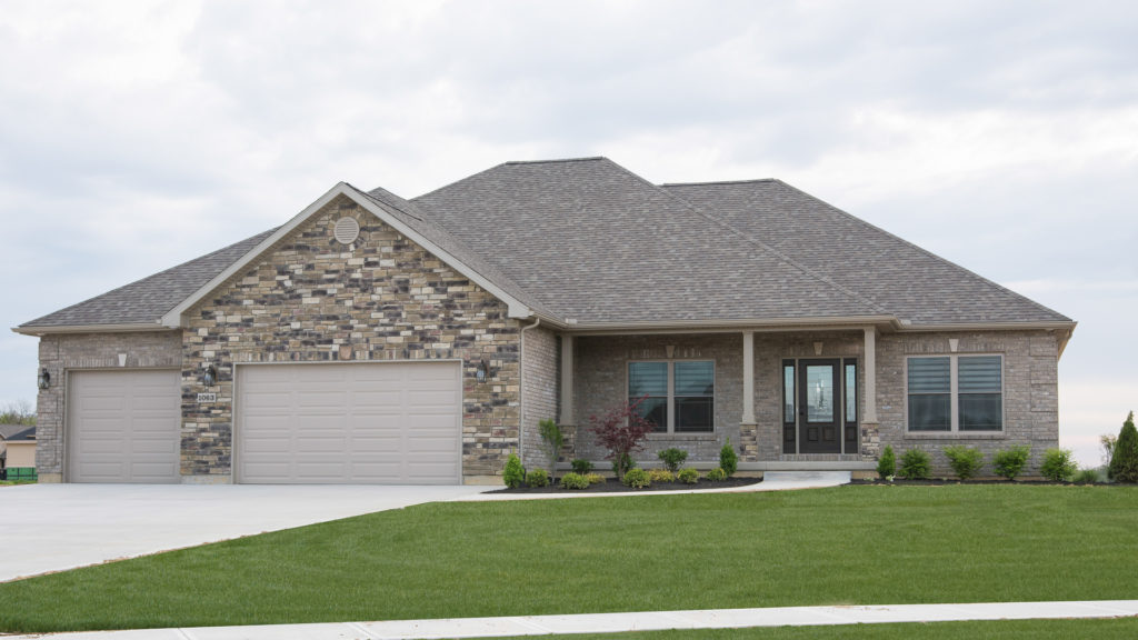 Allison model features Glen-Gery Anchor Bay Queen brick with standard mortar and Sagewood Weather Ledge stone built in Halifax Estates