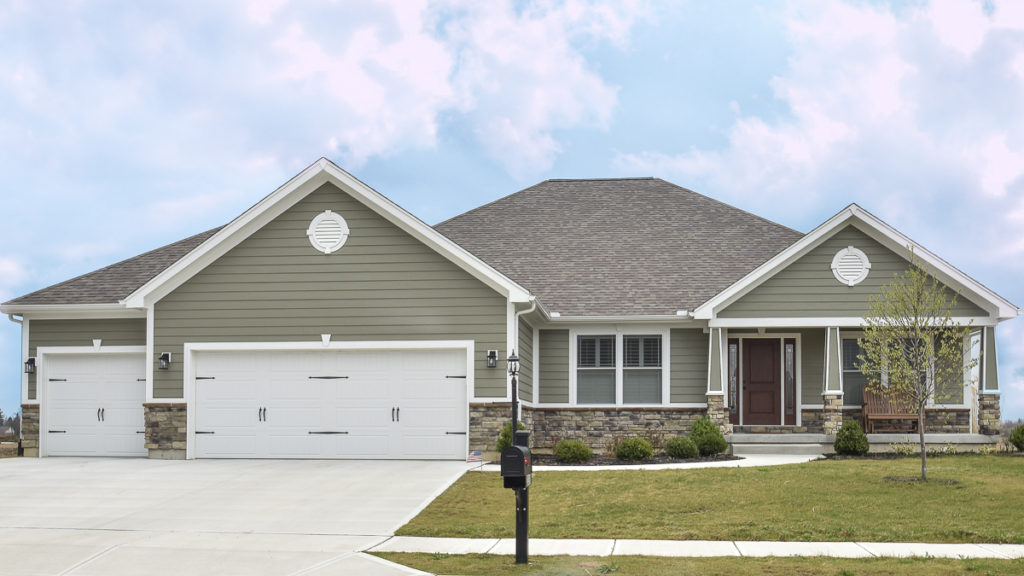 Allison model with Sagewood Weather Ledge stone and painted LP Smart siding built in the Meadows of Stonebridge (Troy)