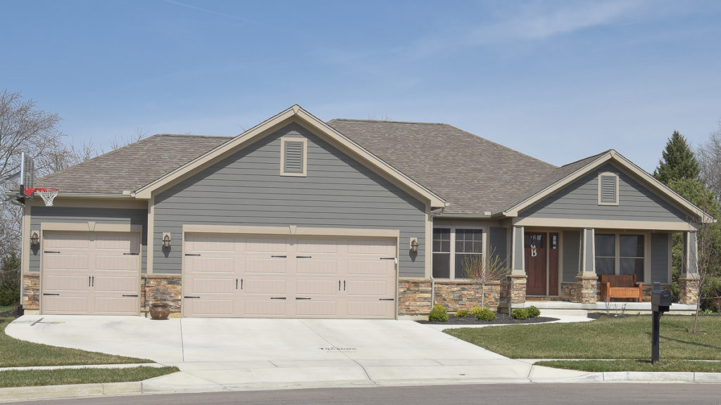 Allison model with Sienna stone and painted LP Smart siding built in the Meadows of Stonebridge (Troy)