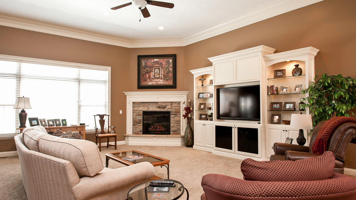 Great room of Allison model features 11 foot ceilings, corner fireplace and entertainment center built ins