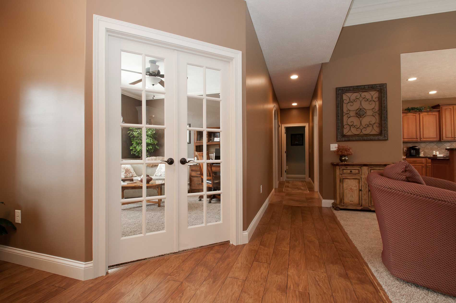 Hallway of Allison model with corner office that features french doors