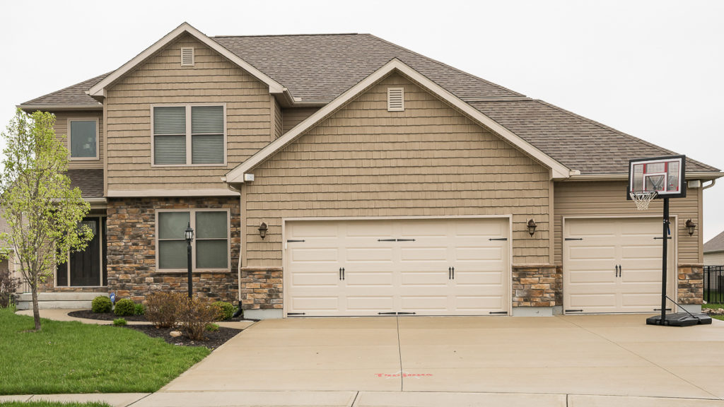 Arlington model with stone and vinyl siding / shakes built in Edgewater (Troy)