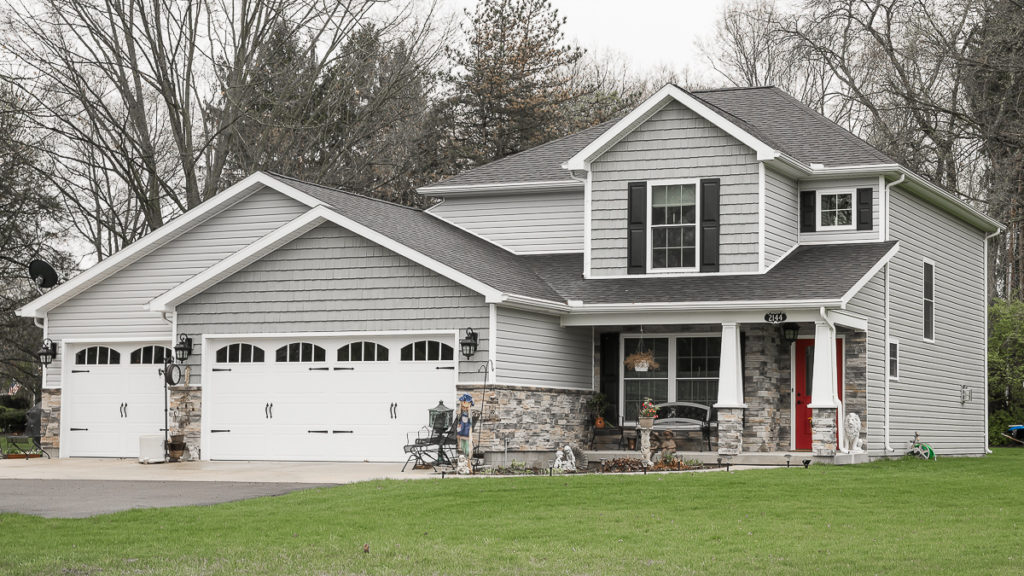 Arlington model with stone and siding built off of Merrimont in Troy