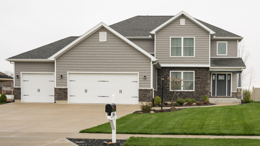 Arlington model with Ashen Weather Ledge stone, and vinyl siding / shakes built in Edegwater (Troy)